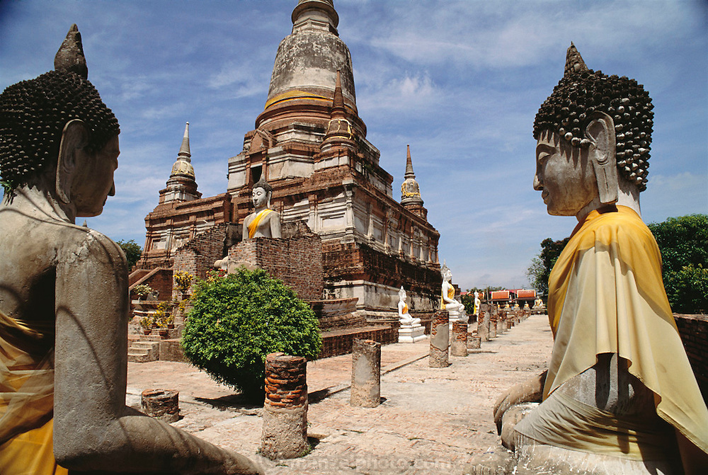 North of Thailand's capital city of Bangkok, at the temple complex of Wat Chae Wattanaram, rows of stone Buddhas (a common image in this overwhelmingly Buddhist nation) testify to his enlightenment, Wat Chae Wattanaram, Thailand. Material World Project.
