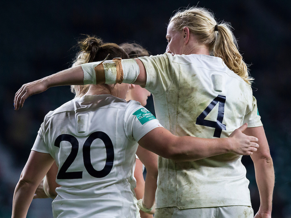 Tamara Taylor puts her arm around Marlie Packer for her part in the build up to Lydia Thompson's try, England Women v Canada Women in an Old Mutual Wealth Series, Autumn International match at Twickenham Stadium, London, England, on 26th November 2016. Full time score 39-6