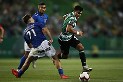 September 1, 2018 - Lisbon, Portugal - Marcos Acuna of Sporting (R) vies for the ball with Fabio Sturgeon of Feirense (L)  during Primeira Liga 2018/19 match between Sporting CP vs CD Feirense, in Lisbon, on September 1, 2018. (Credit Image: © Carlos Palma/NurPhoto/ZUMA Press)