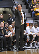 WICHITA, KS - JANUARY 05:  Head coach Gregg Marshall of the Wichita State Shockers points out instructions against the Northern Iowa Panthers during the first half on January 5, 2014 at Charles Koch Arena in Wichita, Kansas.  Wichita State defeated Northern Iowa 67-53. (Photo by Peter Aiken/Getty Images) *** Local Caption *** Gregg Marshall