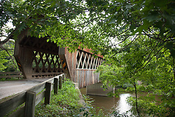 """State Road Bridge, built in 1983 of 97,000 feet of southern pine and oak, was erected in 1983 across Conneaut Creek, Ashtabula county, Ohio.  It is 152-feet-long in a style known as """"Town Lattice."""""""