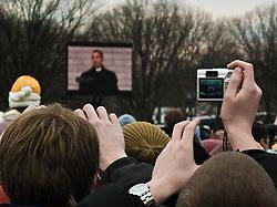 Digital camera taking picture at screen showing Barack Obama at Inaugural Concert for Barack Obama, the National Mall, Washington D.C., USA.