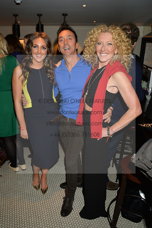 Left to right, NATASHA CORRETT, BRUNO TONIOLI and KELLY HOPPEN at a party to celebrate the publication of Honestly Healthy Cleanse by Natasha Corrett held at Tredwell's Restaurant, 4a Upper St.Martin's Lane, London on 14th January 2015.