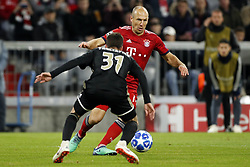 (l-r) Nico Tagliafico of Ajax, Arjen Robben of FC Bayern Munchen during the UEFA Champions League group E match between Bayern Munich and Ajax Amsterdam at the Allianz Arena on October 02, 2018 in Munich, Germany