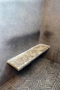 bench in corner of wall with dirty wall