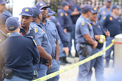 Police stand by as students and academics voice their opinion during the fees must fall protest outside parliament in Cape Town, Western Cape,  South Africa<br /> <br /> Photo: Masixole Feni