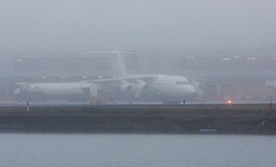© Licensed to London News Pictures. 30/12/2016. LONDON, UK.  A CityJet plane sits on the runway at London City Airport, shrouded in fog this morning. London is experiencing more freezing and foggy weather this morning which has disrupted and delayed flights and travel.  Photo credit: Vickie Flores/LNP