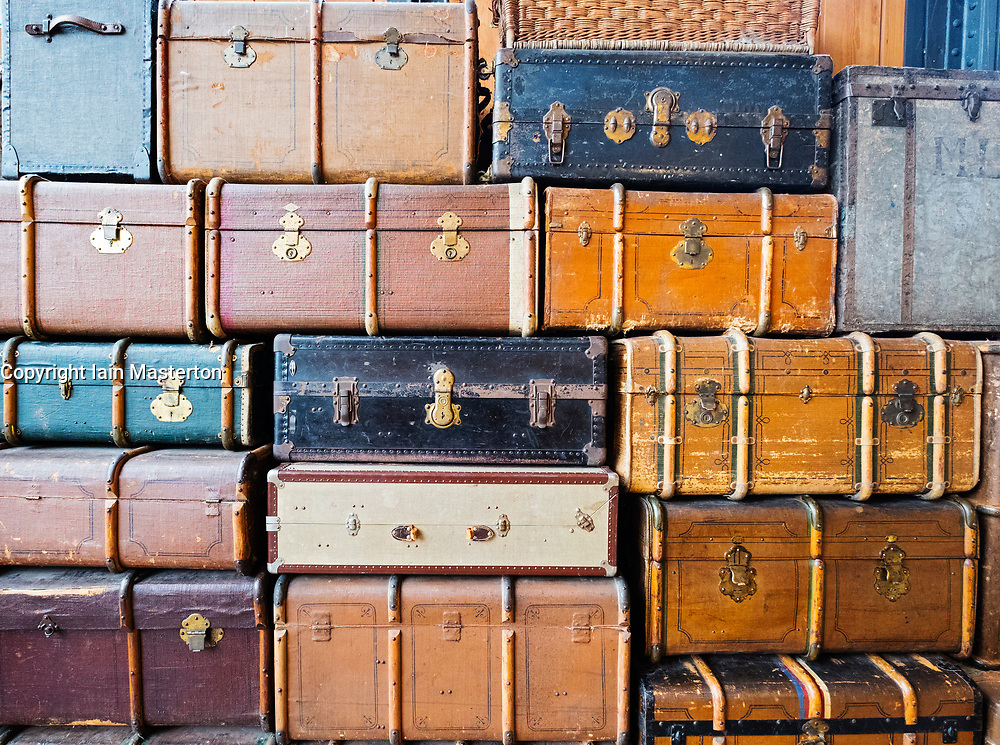 Many old suitcases stacked up