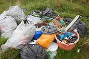 A pile of assorted plastic materials await removal from the coastal landscape, having been collected by volunteers from a beach on Holy Island, on 27th September 2017, on Lindisfarne Island, Northumberland, England. The amount of rubbish found dumped on UK beaches rose by a third last year, according to a new report. More than 8,000 plastic bottles were collected by the Marine Conservation Society's annual beach clean-up at seaside locations from Orkney to the Channel Islands on one weekend in September 2016. The Holy Island of Lindisfarne, also known simply as Holy Island, is an island off the northeast coast of England. Holy Island has a recorded history from the 6th century AD; it was an important centre of Celtic and Anglo-saxon Christianity. After the Viking invasions and the Norman conquest of England, a priory was reestablished.