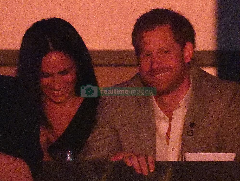 Prince Harry, Meghan Markle and Meghan's Mother Doria Radlan, attend The Invictus Games 2017 Closing Ceremony at the Air Canada Centre, Toronto, Ontario, Canada, on the 30th September 2017. 30 Sep 2017 Pictured: Meghan Markle, Prince Harry. Photo credit: James Whatling / MEGA TheMegaAgency.com +1 888 505 6342