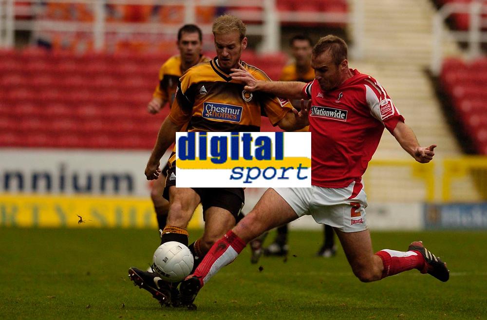 Photo: Alan Crowhurst.<br />Swindon Town v Boston Utd. The FA Cup. 05/11/2005. Boston's Lawrie Dudfield (L) and Sean O'Hanlon challenge for the ball.