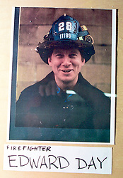 14 September 2001. New York, New York - USA.<br /> Post 9/11 World Trade Center attack.<br /> Edward Day, firefighter. Missing presumed dead. Hero firefighter, colleague of Mike Kehoe of Engine 28, Ladder 11 pictured in a memorial erected at their firehouse on East 2nd Street in the East village early in the morning of Sept 14th. <br /> Mike Kehoe's image had been published the day before on front pages around the world. It is the iconic image of him ascending the stairs of the World Trade Center as he helped to evacuate people from the terrorist attacks of 9/11. It was assumed Mike had perished when the buildings collapsed. However Mike had miraculously managed to escape the buildings moments before they collapsed. 6 members of his crew were not so fortunate. Mike became a symbol of heroism to many following the vicious Al Queda attacks which claimed over 2,000 victims at the WTC site. This images was published exclusively on the Front Page of the Daily Mirror on 15th Sept, 2001.<br /> Photo exclusive©; Charlie Varley/varleypix.com