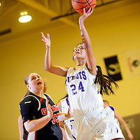 022414  Adron Gardner/Independent<br /> <br /> Miyamura Patriot Amber Antez (24), right, releases a shot ahead of Grants Pirate Kami Bratzel (33) at Miyamura High School in Gallup Monday.