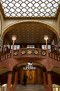 One staircase entrance to Kino Lucerna (cinema) in the marbled atrium kiosk in Lucerna Gallery, on 19th March, 2018, in Prague, the Czech Republic. Lucerna is the most elegant of Nove Mesto's many shopping arcades runs through the art-nouveau Lucerna Palace (1920), between Stepanska and Vodickova streets. The complex was designed by Vaclav Havel (grandfather of the former president), and is still partially owned by the family. It includes theatres, a cinema, shops, a rock club and several cafes and restaurants. Here St Wenceslas sits astride a horse that is decidedly dead; it's safe to assume this is a reference to Vaclav Klaus, president of the Czech Republic from 2003 to 2013.