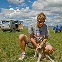 MONGOLIA. Nick Wiltsie & puppy near Lake Erkhel.
