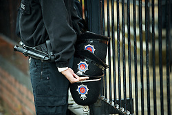 © Licensed to London News Pictures . 15/07/2016 . Bolton , UK . A police officer holding three helmets behind his back on the street outside the church , after the service .  The funeral of Special Constable Samantha Derbyshire at St Mary's RC Church in Horwich , Bolton. Derbyshire was struck and killed by an HGV on the M61 motorway following a collision , in the early hours of Monday 11th July 2016 . Photo credit : Joel Goodman/LNP