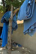 Balkh province Afghanistan. Samarkand-Dion. Women's education class. Burkhas left outside the classroom.