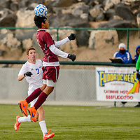 Rehoboth Lynx D'Andre Palmore (11) leaps for a header during a quarterfinal match against the Bosque Bobcats in the state soccer tournament at the Albuquerque Public Schools soccer complex in Albuquerque Thursday.