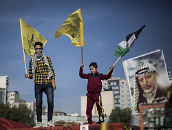 November 20, 2018 - Gaza City, The Gaza Strip, Palestine - Palestinian Fatah supporters take part in a rally to mark the 14th anniversary of the death of late Palestinian leader Yasser Arafat in Gaza City on November 20, 2018. (Credit Image: © Mahmoud Issa/Quds Net News via ZUMA Wire)