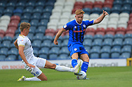Callum Camps is challenged  during the EFL Sky Bet League 1 match between Rochdale and Peterborough United at Spotland, Rochdale, England on 11 August 2018.