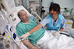 Staff Nurse attending to patient in the Adult Intensive Care Unit,