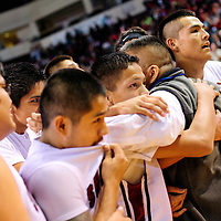 031313  Adron Gardner/Independent<br /> <br /> The Shiprock Chieftain team hugs coach Chester Atcitty after beating the Portales Rams in the 3A New Mexico High School Basketball tournament quarterfinals at Santa Ana Star Center in Rio Rancho Wednesday.