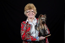 © Licensed to London News Pictures. 10/03/2016. Birmingham, UK. Carol Smith with her Yorkshire Terrier named Dora at Crufts 2016 held at the NEC in Birmingham, West Midlands, UK. The world's largest dog show, Crufts is this year celebrating it's 125th anniversary. The annual event is organised and hosted by the Kennel Club and has been running since 1891. Photo credit : Ian Hinchliffe/LNP