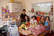 (MODEL RELEASED IMAGE). The Brown family of Riverview, Australia with a week's worth of food: Doug Brown, 54, and his wife Marge, 52, with their daughter Vanessa, 32, and her children, Rhy, 12, Kayla, 15, John, 13, and Sinead, 5. The length of the Brown's grocery list changes depending on whether Vanessa and her children are living with them at the moment. The Brown family is one of the thirty families featured in the book Hungry Planet: What the World Eats (p. 22).