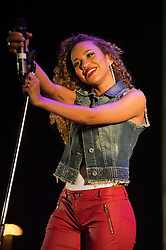 """""""Cover Drive"""" are from Barbados and fronted by the gorgeous Amanda backed by T-Ray, Bar-Man and Jamar perform at Meadowhalls Christmas lights switch on concert in Sheffield on Thursday evening 3 November 2011. Image © Paul David Drabble"""