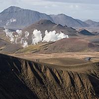...the same tourists walking along the Stóra-Víti crater's rim. The steam emanate from the Kröflustöð geothermal power station.