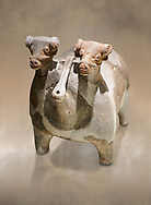 Bronze Age Anatolian terra cotta vtwo headed bull shaped ritual vessel - 19th to 17th century BC - Kültepe Kanesh - Museum of Anatolian Civilisations, Ankara, Turkey.  Against a warn art background. .<br /> <br /> If you prefer to buy from our ALAMY PHOTO LIBRARY  Collection visit : https://www.alamy.com/portfolio/paul-williams-funkystock/kultepe-kanesh-pottery.html<br /> <br /> Visit our ANCIENT WORLD PHOTO COLLECTIONS for more photos to download or buy as wall art prints https://funkystock.photoshelter.com/gallery-collection/Ancient-World-Art-Antiquities-Historic-Sites-Pictures-Images-of/C00006u26yqSkDOM
