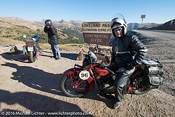 Doug Jones riding his 1929 Indian 101 Scout stops for a photo while crossing the Continental Divide at the top of Loveland Pass during Stage 10 (278 miles) of the Motorcycle Cannonball Cross-Country Endurance Run, which on this day ran from Golden to Grand Junction, CO., USA. Monday, September 15, 2014.  Photography ©2014 Michael Lichter.