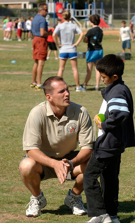 Round Rock, TX September 28, 2006: A student teacher in physical education works with students at Great Oaks Elementary, a suburban school north of Austin. ©Bob Daemmrich /