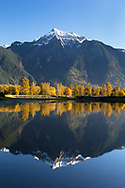 Reflection of Mount Cheam in the waters of Maria Slough at Seabird Island(Sq'éwqel), Agassiz, British Columbia, Canada
