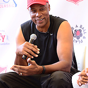 PHILADELPHIA, PA - SEPTEMBER 12:  Julius Erving speaks to children during Q & A at The Julius Erving Youth Basketball Experience at the Salvation Army Kroc Center on September 12, 2015 in Philadelphia, Pennsylvania.  (Photo by Lisa Lake/Getty Images for the Julius Irving Golf Classic)