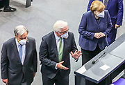 Secretary General of the United Nations, António Guterres (L), German Chancellor Angela Merkel (R), German Federal President Frank-Walter Steinmeier (R) make their way out of the Bundestag in Berlin, Germany, December 18, 2020. Guterres was invited as an honorary guest on the occasion of  the founding of the United Nations 75 years ago. <br /> (Photo by Omer Messinger)