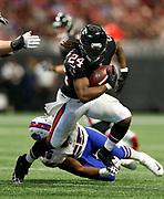 Atlanta Falcons running back Devonta Freeman (24) runs during a week 4 NFL football game against the Buffalo Bills on Sunday, Oct. 1, 2017 in Atlanta, GA. (Mike Zarrilli/AP Images for Panini, via AP)