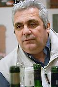 Jean-Louis Poudou with lots of bottles. Domaine La Tour Boisee. In Laure-Minervois. Minervois. Languedoc. Owner winemaker. France. Europe.