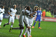 Swansea city's Dwight Tiendalli ©  celebrates with Jose Canas (r)after he scores his sides 1st goal to make it 1-1.  Barclays Premier league, Swansea city v Everton at the Liberty Stadium in Swansea,  South Wales on Sunday 22nd Dec 2013. pic by Andrew Orchard, Andrew Orchard sports photography.