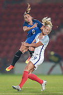 Jessica Houara (France) and Rachel Daly (England) go for a header in midfield during the International Friendly match between England Women and France Women at the Keepmoat Stadium, Doncaster, England on 21 October 2016. Photo by Mark P Doherty.