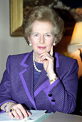 Prime Minister Margaret Thatcher at her desk in 10 Downing Street, London.