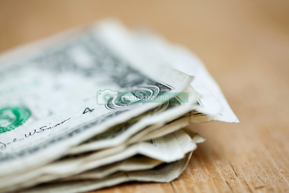 Money on table (Credit Image: © Image Source/Julian Ward/Image Source/ZUMAPRESS.com)