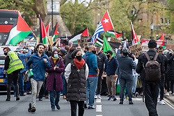 © Licensed to London News Pictures. 16/05/2021. Oxford, UK. People hold placards and flags as they walk over Magdalen Bridge at the 'Speak up for Palestine' demonstration held in Oxford, the crowd marched on the planned route from Manzil Way to Bonn Square in central Oxford. Photo credit: Peter Manning/LNP
