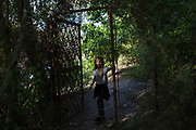 Young girl dances alone in a forest. Model release available