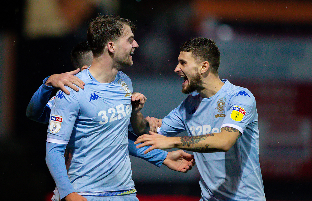 Leeds United's Patrick Bamford celebrates scoring the opening goal with Mateusz Klich<br /> <br /> Photographer Alex Dodd/CameraSport<br /> <br /> The EFL Sky Bet Championship - 191123 Luton Town v Leeds United - Saturday 23rd November 2019 - Kenilworth Road - Luton<br /> <br /> World Copyright © 2019 CameraSport. All rights reserved. 43 Linden Ave. Countesthorpe. Leicester. England. LE8 5PG - Tel: +44 (0) 116 277 4147 - admin@camerasport.com - www.camerasport.com