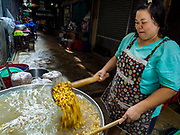 """07 FEBRUARY 2018 - BANGKOK, THAILAND: A woman in Bangkok's """"Chinatown""""  prepares mung beans for desserts consumed during Lunar New Year celebrations. The Lunar New Year, also called Tet or Chinese New Year, is 16 February this year. The coming year will be the Year of the Dog. Thailand has a large Chinese community and Lunar New Year is widely celebrated in Thailand, especially in Bangkok and large cities with significant Chinese communities.      PHOTO BY JACK KURTZ"""
