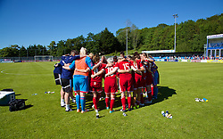 HAVERFORDWEST, WALES - Saturday, June 14, 2014: Wales players form a group huddle after the 1-0 victory over Turkey during the FIFA Women's World Cup Canada 2015 Qualifying Group 6 match at the Bridge Meadow Stadium. (Pic by David Rawcliffe/Propaganda)