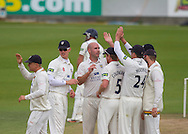 Chris Rushworth (Durham County Cricket Club) is congratulated by team mates after taking the wicket of Laurie Evans (Warwickshire County Cricket Club) during the LV County Championship Div 1 match between Durham County Cricket Club and Warwickshire County Cricket Club at the Emirates Durham ICG Ground, Chester-le-Street, United Kingdom on 15 July 2015. Photo by George Ledger.