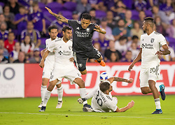 April 21, 2018 - Orlando, FL, U.S. - ORLANDO, FL - APRIL 21: Orlando City defender Yoshimar Yotun (19) gets fouled during the MLS soccer match between the Orlando City FC and the San Jose Earthquakes at Orlando City SC on April 21, 2018 at Orlando City Stadium in Orlando, FL. (Photo by Andrew Bershaw/Icon Sportswire) (Credit Image: © Andrew Bershaw/Icon SMI via ZUMA Press)