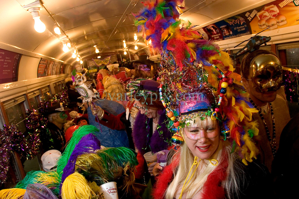 06 Jan, 2006. New Orleans, Louisiana.  Post Katrina aftermath.<br /> 12th Night, New Orleans, Louisiana. Mardi Gras begins. The Mardi Gras krewe of Phunny Phorty Phellows gather on Canal Street to take a street car through the city. Their traditional route along St Charles Ave had to be cancelled because street cars are still unable to travel the route.Diana Preston and her large hat predominate the street car.<br /> Photo; Charlie Varley/varleypix.com